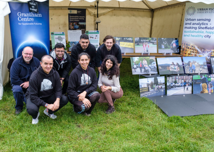 The team of the Grantham Centre for Sustainable Futures poses in front of their stall. Photo by Jeremy Abrahams