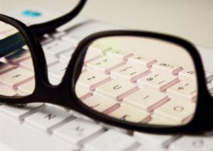 Glasses on a key board